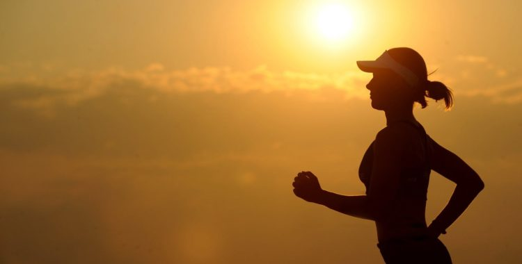 runner with sun in the distance