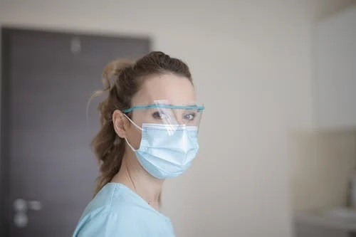 a woman in PPE