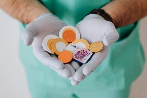 coins in a doctor's hand