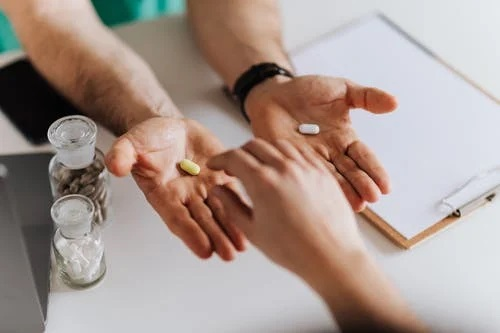 a person taking medication
